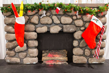 some christmas stockings above fireplace photo