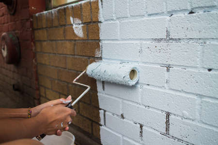 brick: painting on a fresh coat on brick wall
