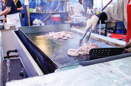 frying squid at night market