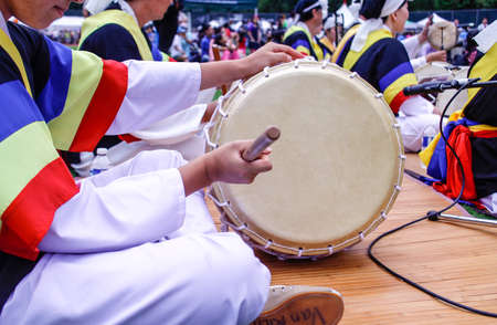 a traditional korean: A traditional Korean drum played at festival grounds