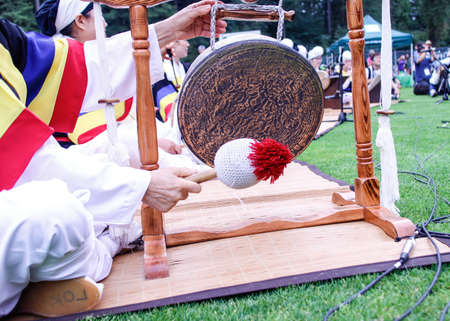 A shiny Korean gong at festival grounds