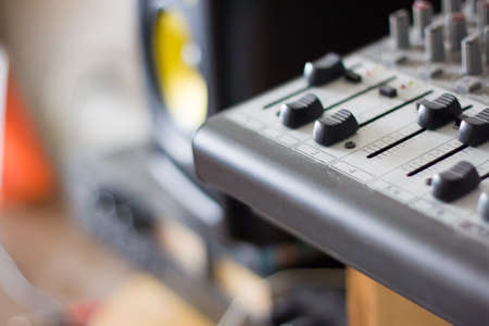 detail of faders on micro mixing board