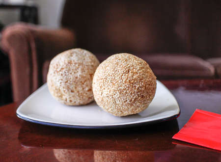 some large Chinese sesame balls on white plate