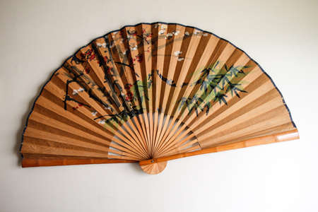 paper fan: a decorative Asian brown paper fan