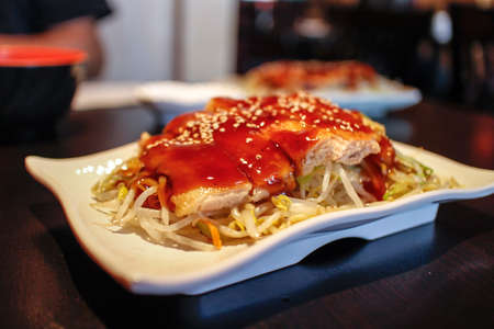 some chicken teriyaki on a white plate Stok Fotoğraf