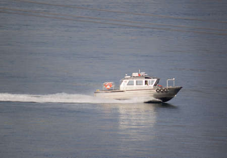 Powerboat speeding quickly back to shore