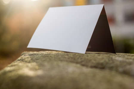 white card on a stone slab Imagens