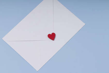Envelope and red heart on blue background. Gift, message for lover. Valentine day greeting concept.