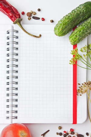 cookbook: Notebook with recipes and shopping list in the kitchen