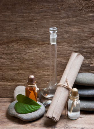 Vials with essential oils against the old wooden walls Stock Photo - 11937863