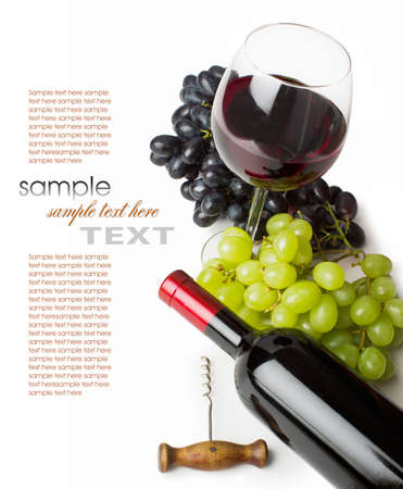glass of red wine with bottle and grapes on a white background photo