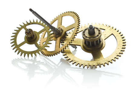 gears from old clock isolated on white background with reflection photo