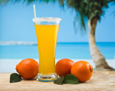 orange juice in a glass on a table with oranges Stock Photo - 12660169