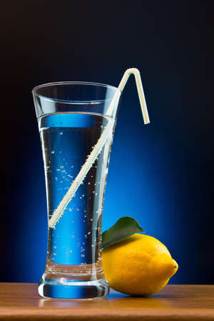 swelter: mineral water and lemon on a colored background