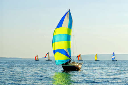 The yacht takes part in competitions in sailing in the sea Stock Photo