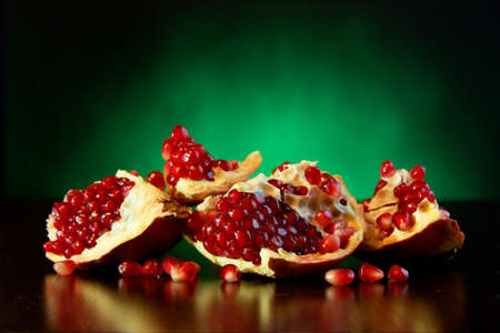 Ripe juicy fruit of the broken pomegranate on a colored background Stock Photo - 12661389
