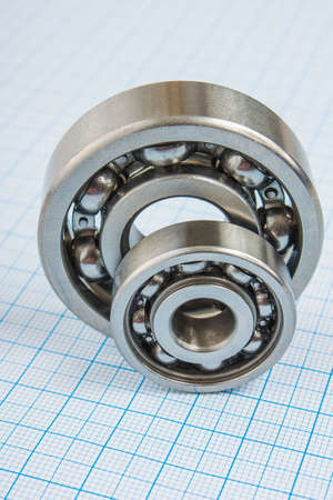 two bearings on the background of graph paper photo