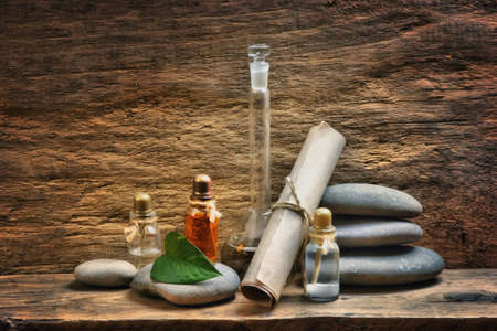 Vials with essential oils against the old wooden walls