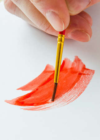 visual art: painting paint brush on a white paper