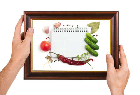 Photo Frame in the hands isolated on white background photo
