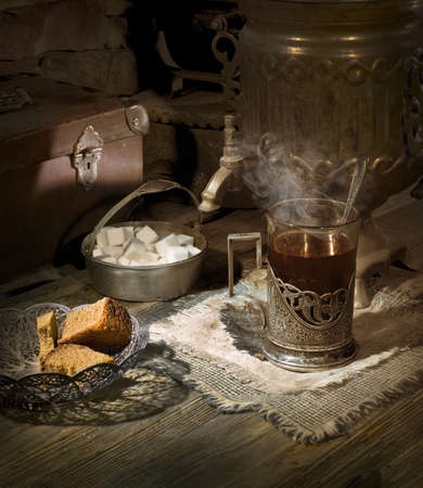 Old samovar on the table with tea and sugar  photo