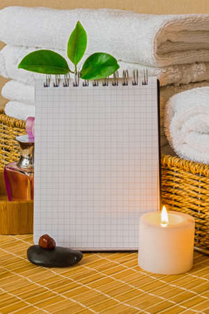 Spa with towels with a candle and pad photo
