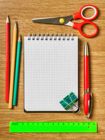 Still life of office supplies with a notebook and accessories photo