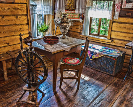 interior of an  Russian log hut with elements of the old way of life