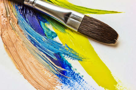 colored paints and brushes for painting on canvas and paper photo