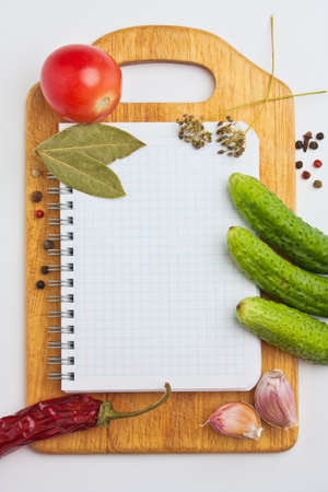 Notebook with recipes and shopping list in the kitchen