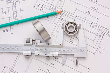 tools and mechanisms detail on the background of technical drawings photo