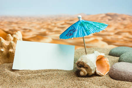 Umbrella on the sand on the background of the beach photo