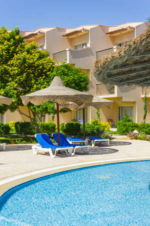 The view from the window of the hotel in Egypt to the pool, sun umbrellas and the Red Sea Stock Photo - 15438718