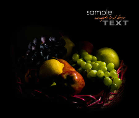 fruit basket: Fruit basket in the dark key on a black background