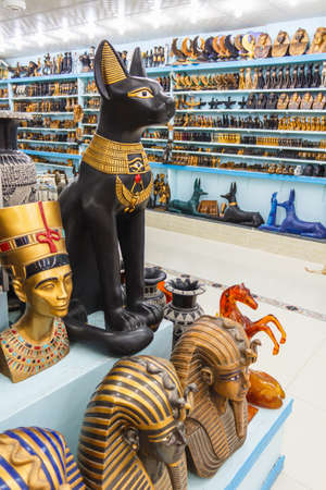 Showcase in the shop with Egyptian souvenirs and statues