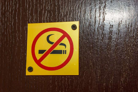 A sign prohibiting smoking on the door to the hotel room photo