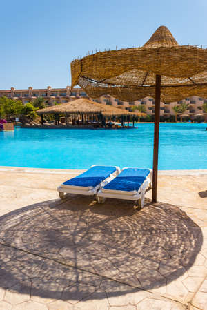 The view from the window of the hotel in Egypt to the pool, sun umbrellas and the Red Sea Stock Photo - 15985278