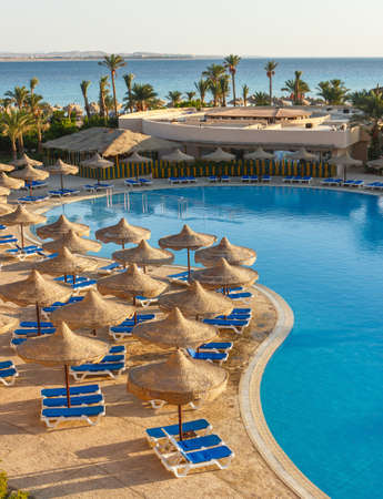 The view from the hotel in Egypt to the pool, sun umbrellas and the Red Sea Stock Photo - 16108931