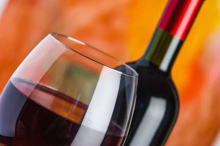 Wine, glass and the bottle on a colored background Stock Photo - 17473630