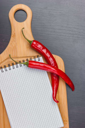 organic peppers sign: vegetables and cooking utensils for cutting table Stock Photo