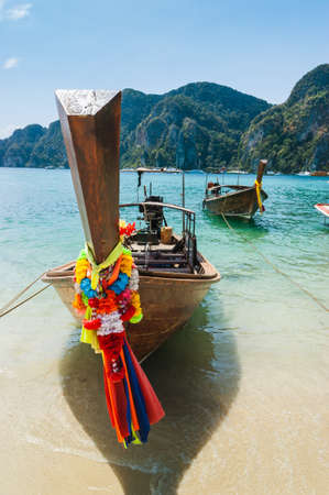 longtail: Boats at sea against the rocks in Thailand. Phi Phi Island Stock Photo
