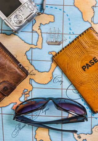 unexplored: Still life with things leisure and travel on a background of map
