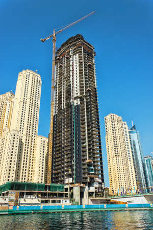DUBAI, UAE - NOVEMBER 16:  Dubai Marina. Construction of skyscrapers in Dubai, UAE,  November 16, 2012. Skyscraper under construction in foreground. Dubai was the fastest developing city in the world between 2002 and 2008.