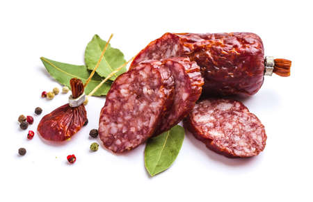 Sliced ​​sausage with spices isolated on white background photo