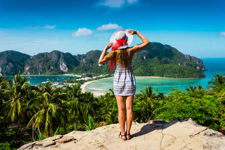 The girl at the resort in a dress and hat on the background of the bays of the island of Phi Phi photo