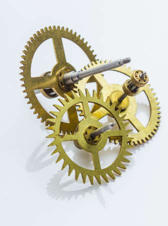 escapement: Gear of the clock on a white background Stock Photo