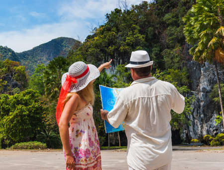 Tourists choose the route through the jungle in Thailand on Phuket Island photo