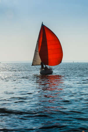 The yacht takes part in competitions in sailing in the sea photo