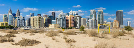 DUBAI, UAE - NOVEMBER 17: Midday heat in the desert in the background buildingsl on Nov 17, 2012 in Dubai UAE
