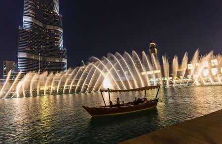 DUBAI, UAE - NOVEMBER 13: A record-setting fountain system set on Burj Khalifa Lake - 6600 lights and 25 projectors, it shoots water 150 m into the air, at November 13, 2013 in Dubai, UAE.